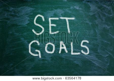 Set Goals Words On Chalkboard Background