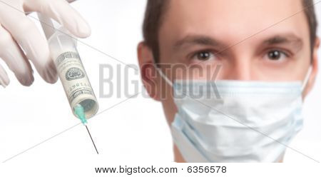 Man In Mask Pointing With Money Syringe Close-up