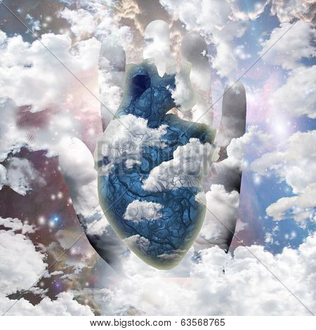 Clouds heart and human hand