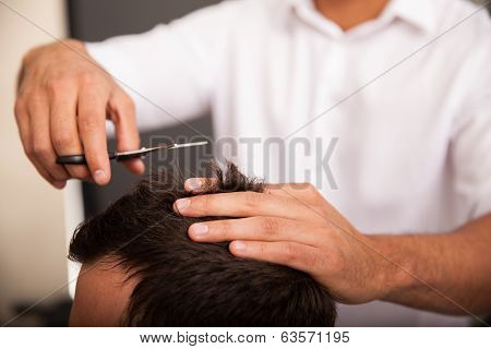 Closeup Of A Barber At Work