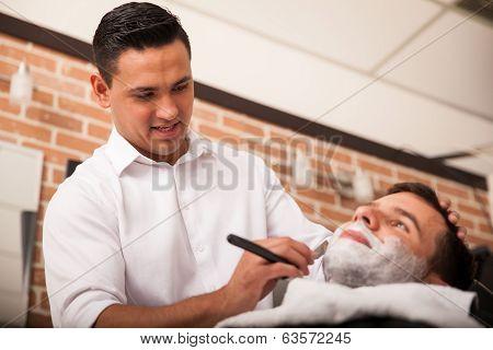 Young Barber Enjoying His Work
