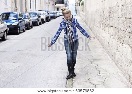 Girl Walking On A City Street