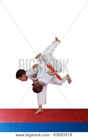 Training a throw judo athletes in  white kimono