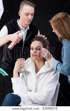 Hairdresser And Make-up Artist Working