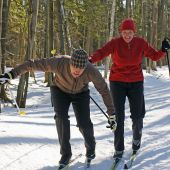 stock photo of nordic skiing  - Baby Boomers playing around on cross country skis at a resort in Ontario - JPG