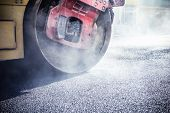 foto of heavy equipment operator  - Road roller repairing asphalt pavement - JPG