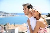 foto of visitation  - Happy couple of tourists visiting Ibiza island in summer - JPG