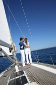 Fancy couple enjoying sailing on a beautiful sailboat