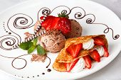 picture of dainty  - Delicious golden freshly baked strawberry and cream pancake with chocolate ice cream for a gourmet dessert - JPG