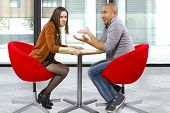 stock photo of rude  - rude interracial couple on a bad date - JPG