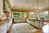 stock photo of combinations  - Spacious kitchen room with antiqu storage combination - JPG