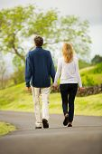 Mature middle age couple in love walking in countryside