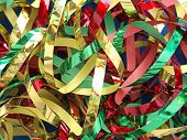 Closeup of twisted and tangled party streamers in red, green and golden color