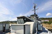 stock photo of battleship  - The battleship in the garden and blue sky - JPG