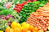 stock photo of cowslip  - Organic fresh vegetables and salad organized in a market - JPG