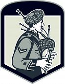 stock photo of bagpiper  - Illustration of a scotsman bagpiper playing bagpipes viewed from side set inside shield crest on isolated background done in retro woodcut style - JPG
