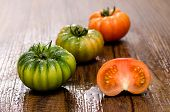 stock photo of crudites  - Green and red bovine heart tomatoes Coure di Bue - JPG