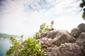 pic of samadhi  - Yoga meditation in yoga pose by woman on the peak of mountain - JPG