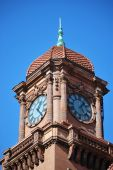 picture of amtrak  - A French Renaissance style red brick clock tower on a popular American train station against vibrant blue skies - JPG