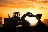 picture of excavator  - heavy wheel excavator machine working at sunset - JPG