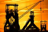 Steel plant in silhouette image in sunset