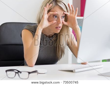 Tired woman in front of computer