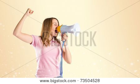 Blonde Girl Shouting With A Megaphone Over Gloss Background