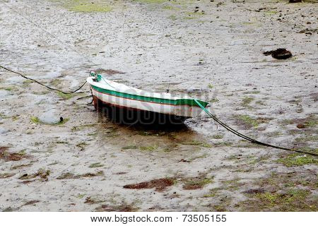 Boat on the wet sand at low tide