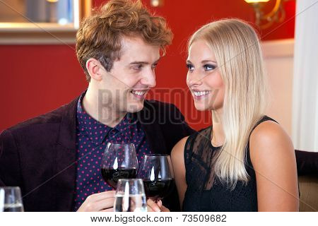 Happy Couple Celebrating With Red Wine