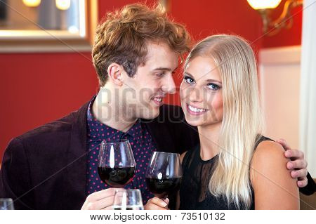 Smiling Romantic Couple Having Wine