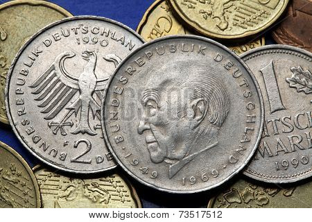 Coins of Germany. German statesman Konrad Adenauer and the German eagle depicted in old Deutsche Mark coins.
