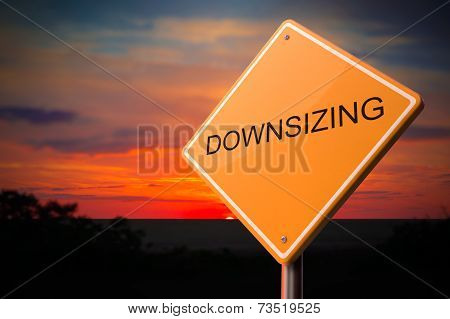 Downsizing on Warning Road Sign.