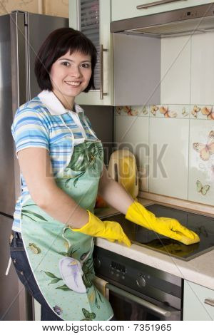 Smiling Woman Cleaning  Cooker