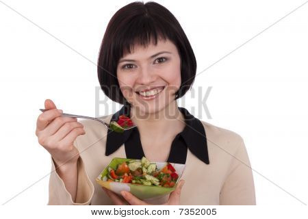 Woman Holding Plate With Salad And Eating