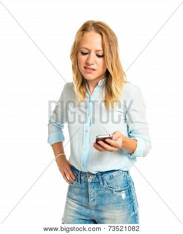 Blonde Girl With Her Mobile Over White Background