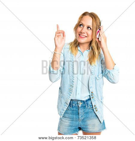Young Woman Listening Music Over White Background