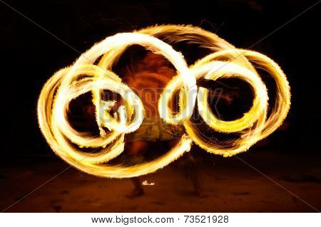 TONGATAPU, TONGA - NOVEMBER 13: An unidentified man performs fire dance (blurred motion) in Hina cav