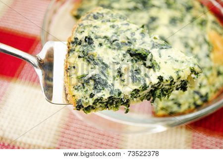 Close Up Of A Serving Of Spinach Quiche