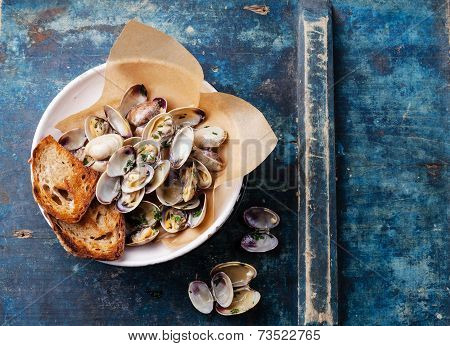 Shells Vongole With Parsley In Vintage Ceramic Colander On Blue Background