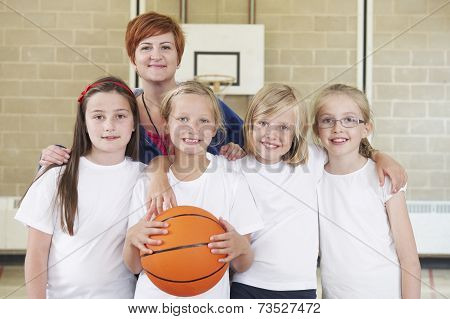 Teacher With Girls School Basketball Team