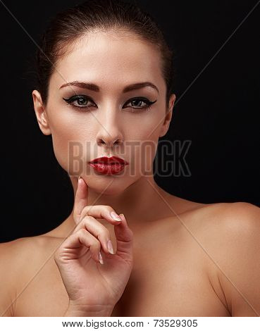Beautiful Makeup Woman With Eyeliner On Eyes And Red Lipstick. Closeup