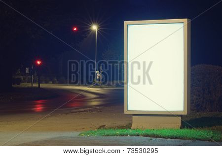 Advertising billboard glowing in the street