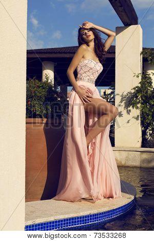 Pretty Brunette In Luxurious Silk Dress Posing At Summer Garden