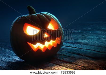 Halloween pumpkin on rough wooden planks ( jack o'lantern )