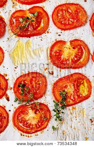 Baked Tomatoes On Textured Background