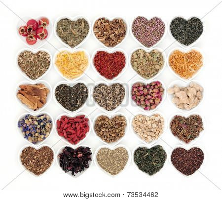 Large herb tea selection in heart shaped porcelain bowls over white background. Also used in natural alternative medicine.