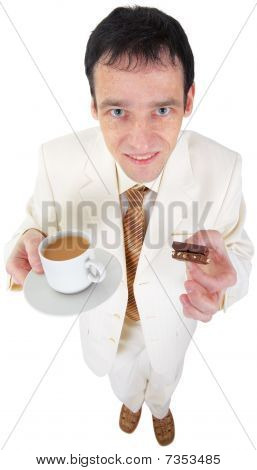 Funny Young Man Drinking Coffee With Sweets