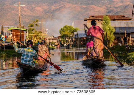 Burmese Women Rowing On Wooden Boats, Inle Lake, Myanmar