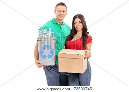 Young couple holding recycle bin and a box isolated on white background
