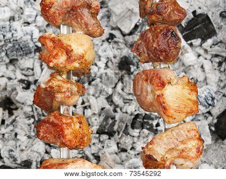 Shish Kebab On Metal Skewers Over Charcoal With Ash